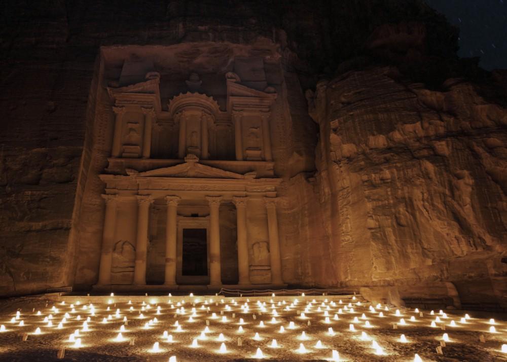 The Treasury, known locally as Al Khazneh, illuminated by hundre