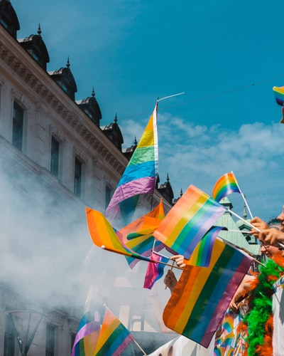 a series of rainbow flags at a festival