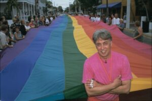 Gilbert Baker with the pride flag