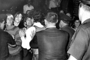 A group fighting with the police