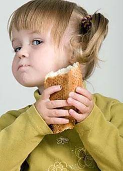 A girl eats a sandwich