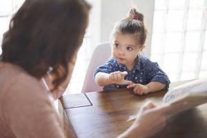 An adult assesses a child