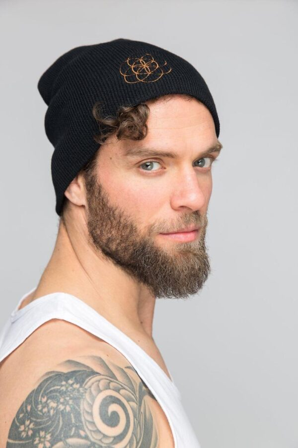 Male model wearing North Flow Yoga slouchy beanie toque