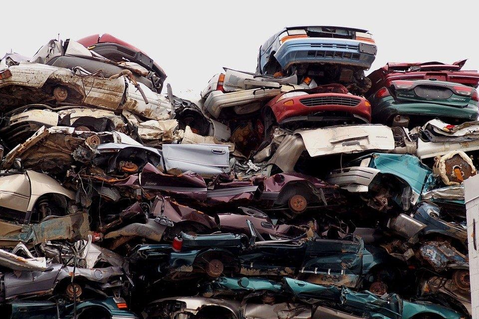 scrap cars piled on top of each other