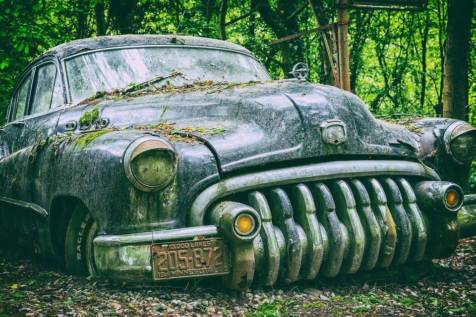 derelict old junk car waiting to be scrapped
