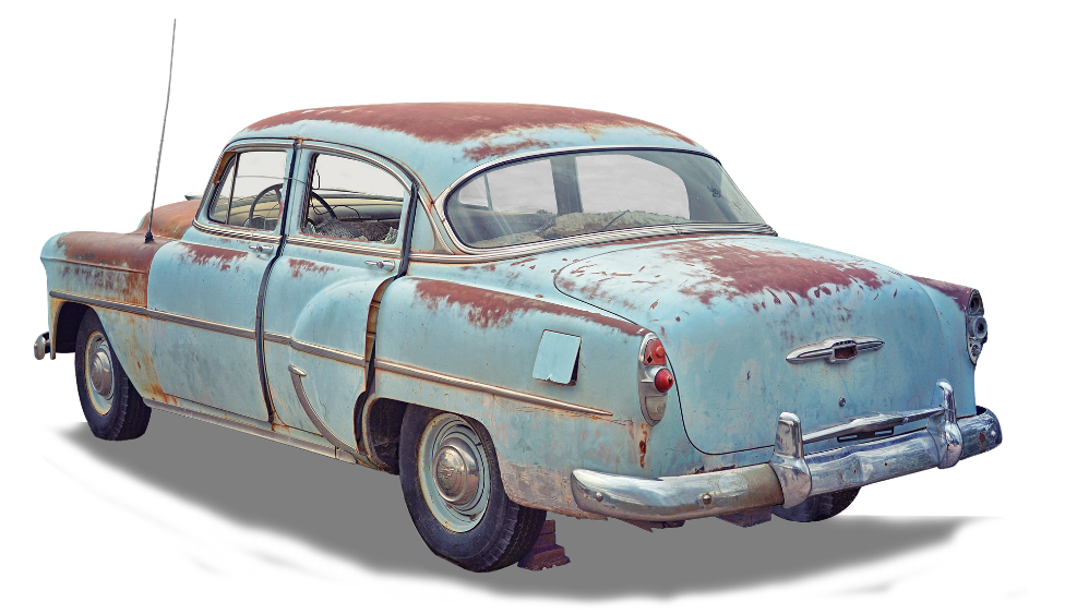 An old worn out blue car.