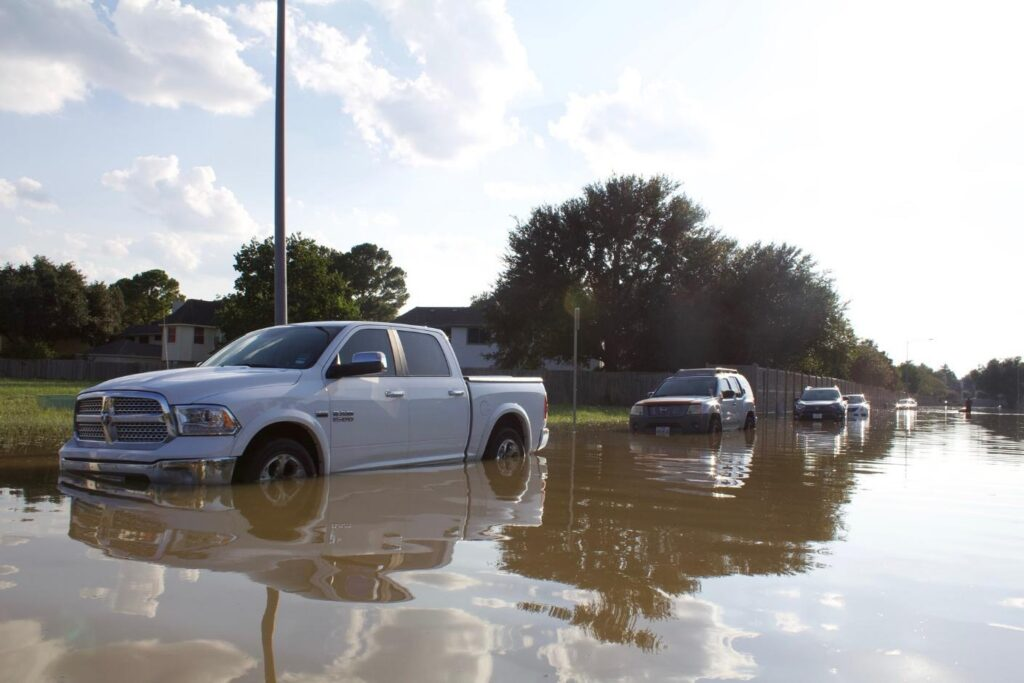 Cars parked on a flooded road