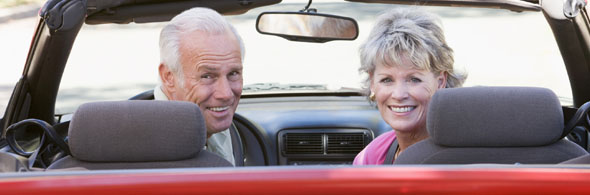 Senior Couple - in convertable looking back