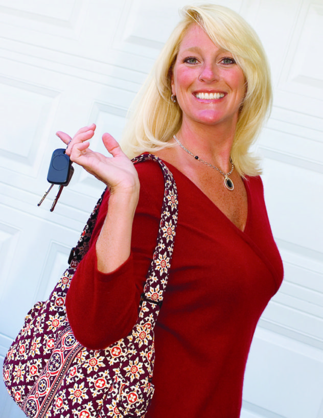 Woman blonde keys red sweater purse