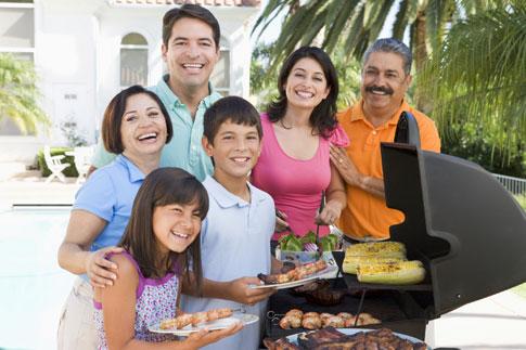 Family enjoying bbq on patio