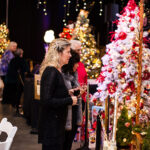 Rogue Winterfest 2016 Gala and Grand Auction Guests Looking at Trees