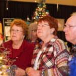 Rogue Winterfest 2016 Golden Social Trio Looking at Tree