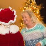 Rogue Winterfest 2016 Golden Social Woman Talking to Mrs. Claus