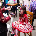 Rogue Winterfest 2016 Weekend Holiday Events Cloe in Striped and Polka Dot Dress Face Painting