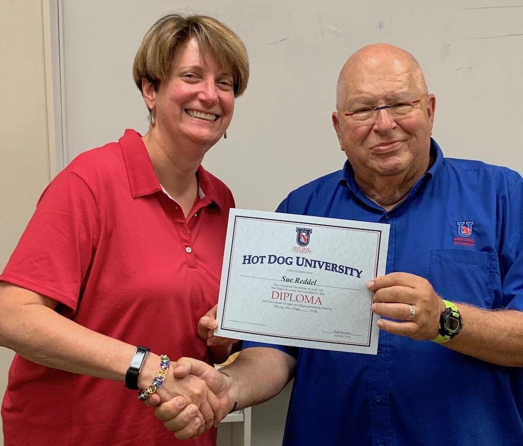 Sue Graduating Hot Dog University