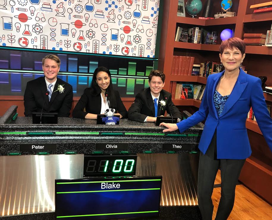 A group of people sitting in front of a television  Description automatically generated