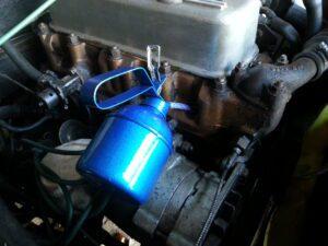 Adding Oil To Spark Plug Hole For Wet Compression Test