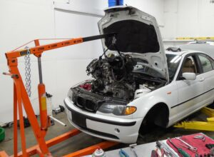 Automotive Mechanic Replacing Engine