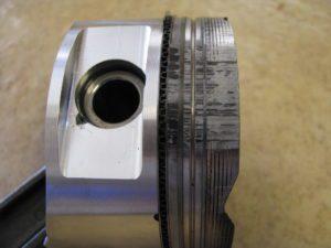 Piston With Fuel Wash Damage