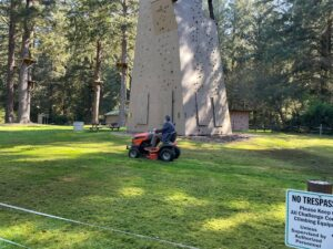 Mike J. mowing the camp grounds