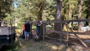 Arrowmen removing an old fence