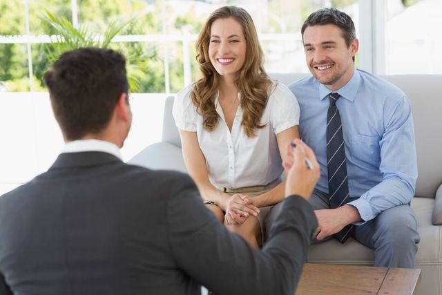 A couple meeting with a property management expert in Dayton, OH