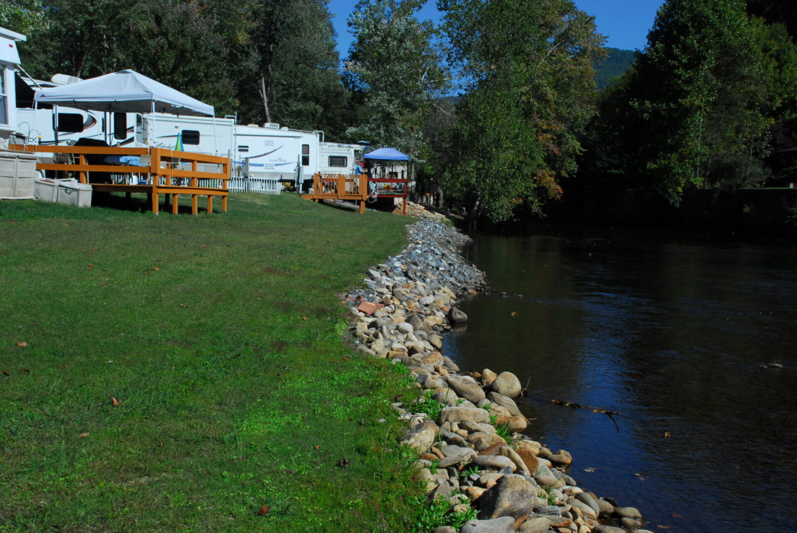 A trailer park on a riverbank