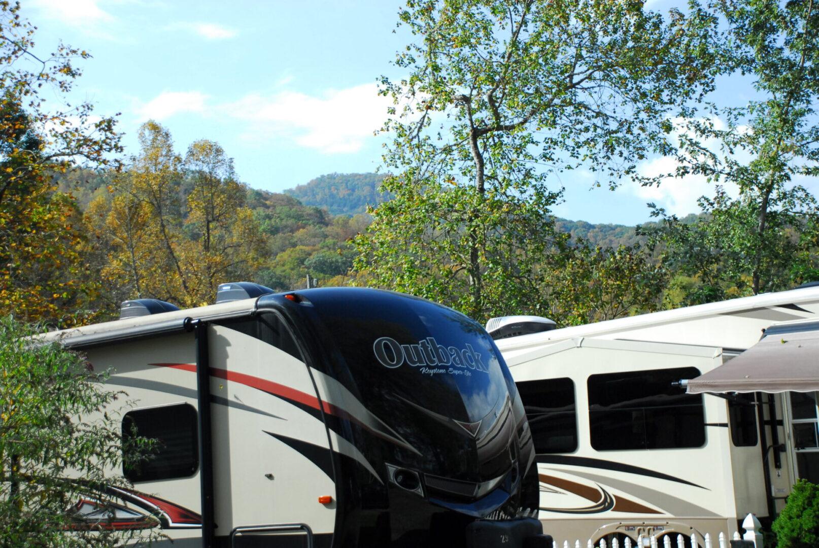 Outback trailer beside a white RV