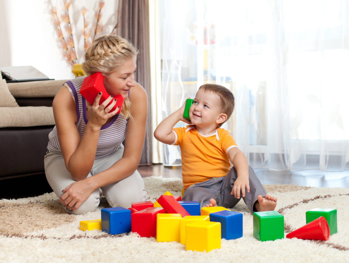 cute mother and kid boy playing together indoor