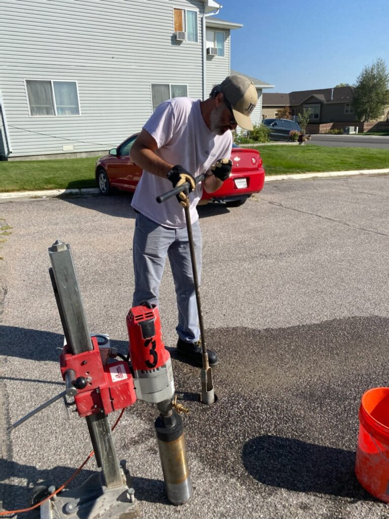 JB Engineers employee using special equipment to test asphalt