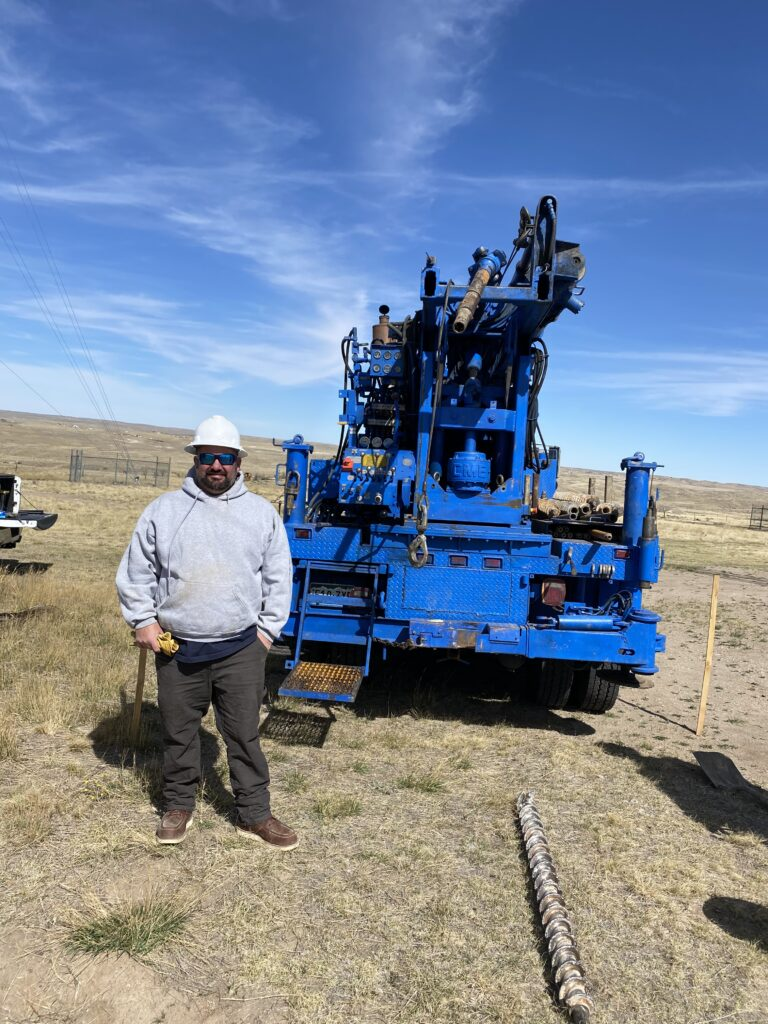 CEO Jared Jung standing in front of drilling machinery