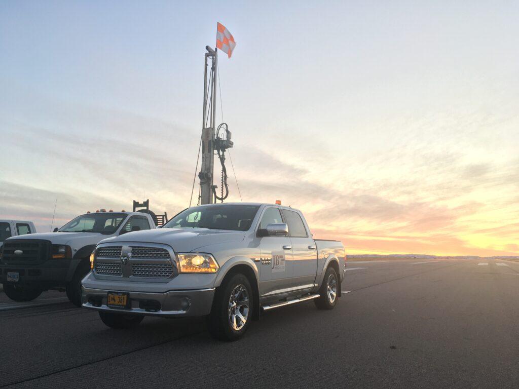 White Dodge Ram work truck lineup at JB Engineers