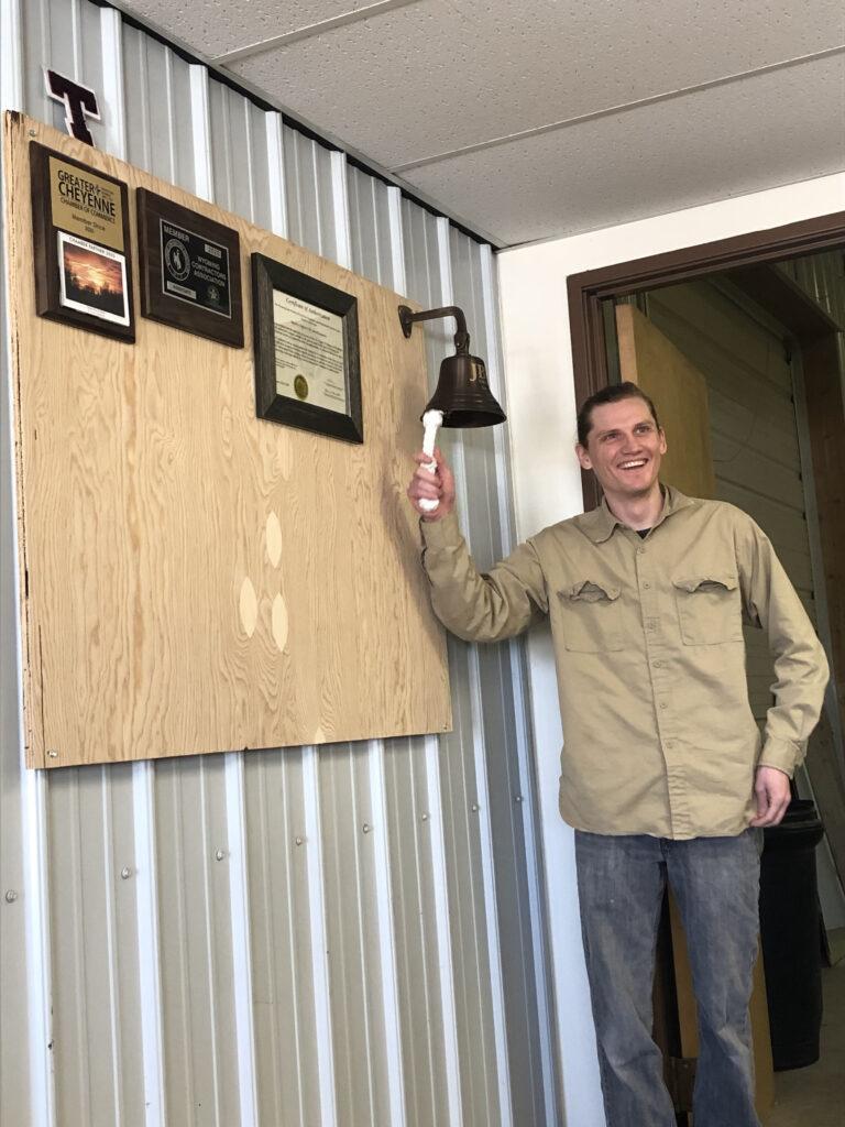 JB engineers employee ringing the work bell