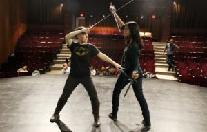 Two person sword fighting on stage