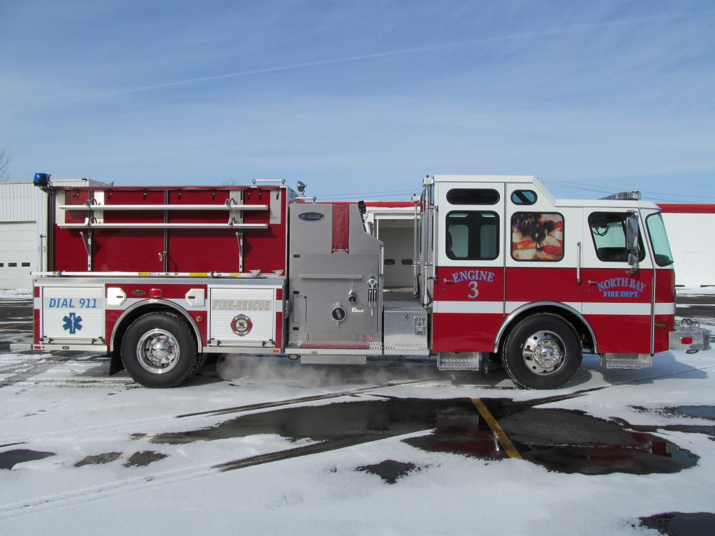 North Bay Volunteer Fire Department, NY E-ONE Stainless Top Mount Pumper - Officer SIde