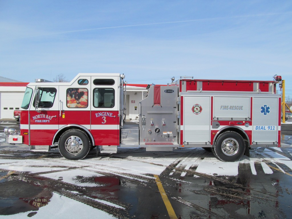North Bay Volunteer Fire Department, NY E-ONE Stainless Top Mount Pumper - Driver Side