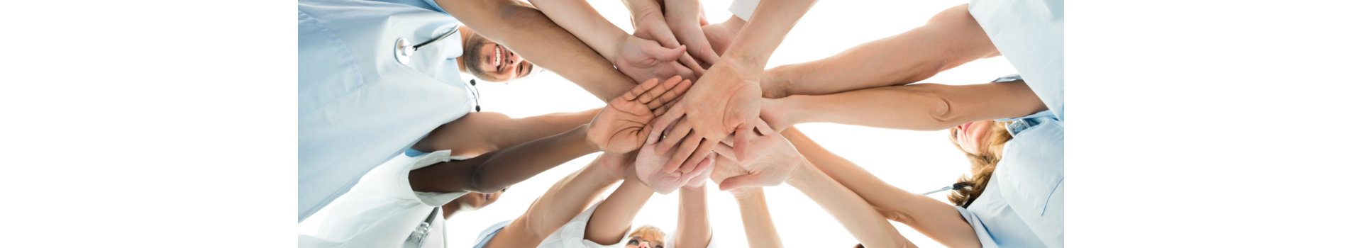 Directly below shot of multiethnic medical team stacking hands