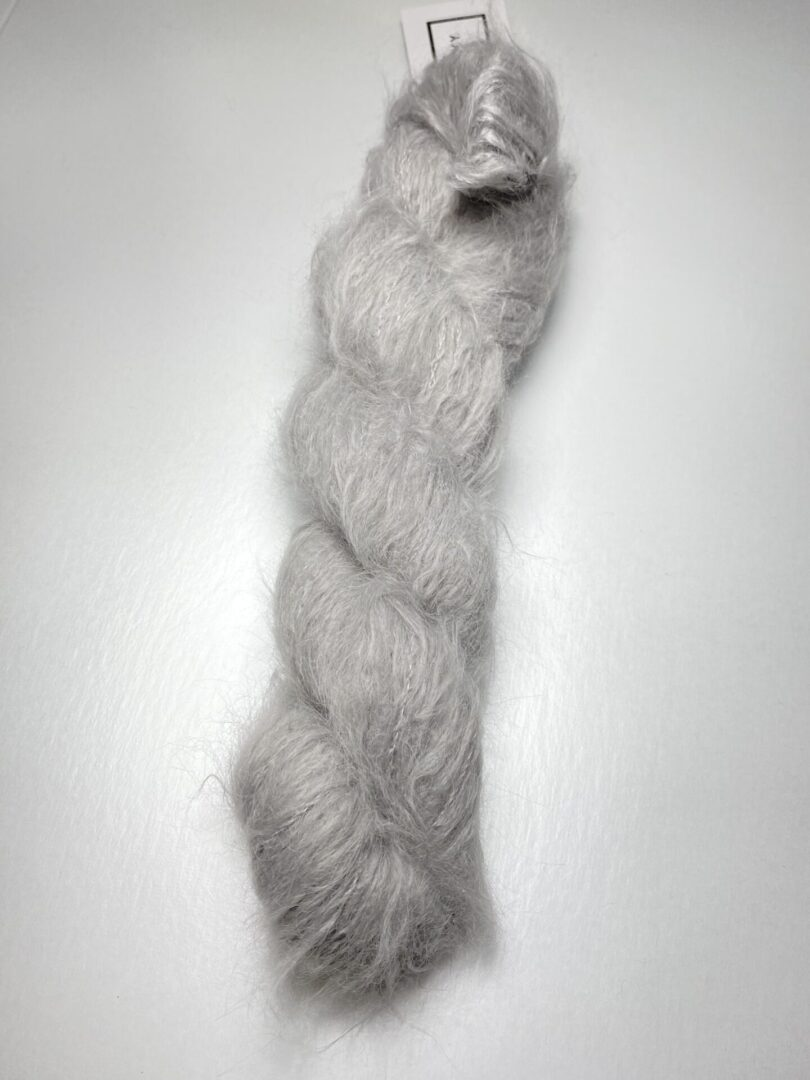 A white furry yarn