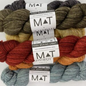 Six assorted colored skeins of yarn