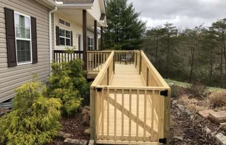wooden ramp leading up to front door of residential house