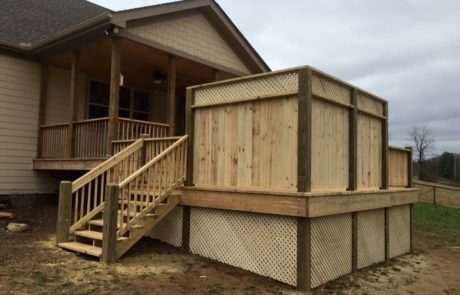 wooden deck with built-in corner private fence