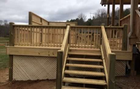 staircase leading up to wooden backyard deck
