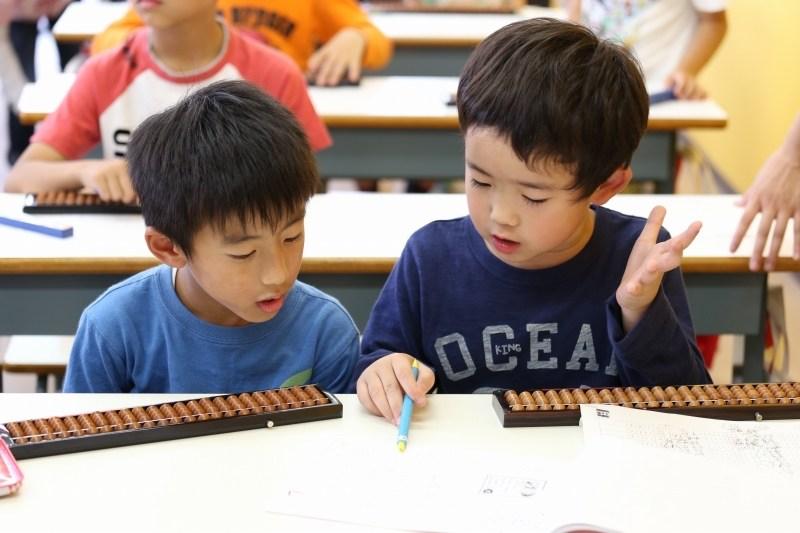 Two kids taking an abacus tutoring junior program near Seattle, WA