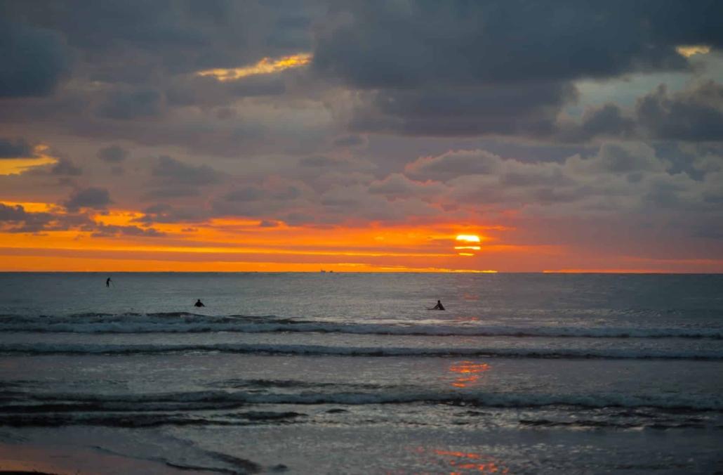 surfing in sunset