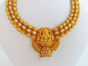 Half Jhumka Pearl Embellished Lakshmi Attigai with Jhumkas