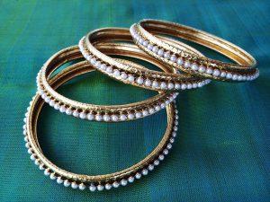 Smooth Gold Pearl Studded Bangles Set
