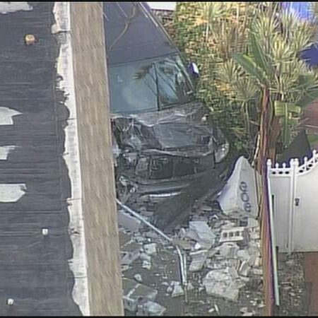Pickup truck collides with scooter before hitting side of building in Miami