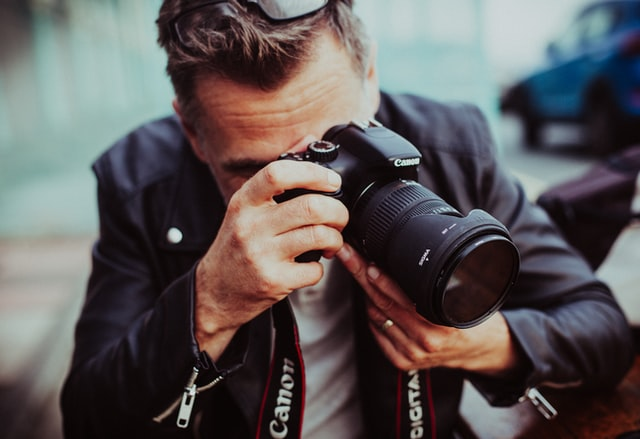 A photo of a photographer. Photography is just one example of many side business ideas that you can think about.