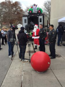 Santa with Westland Police Officers doing interview for the news for the Stuff A Swat Truck Event