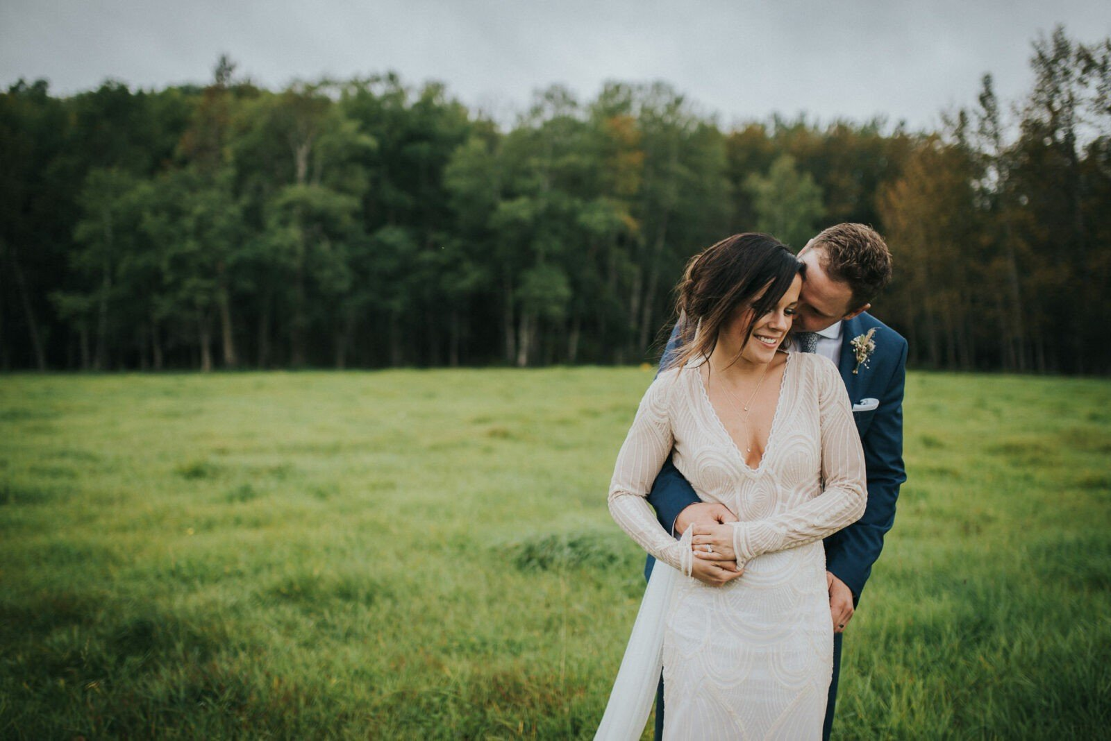 Newlyweds celebrate in the forest.